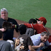 Martin Prado chases foul ball, bumps heads with fan (Video)