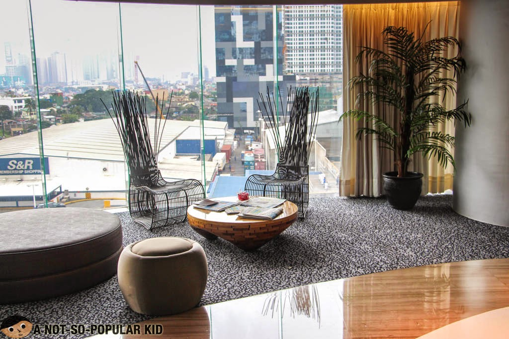 The lobby of F1 Hotel Manila with a good view of the S&R and W Tower