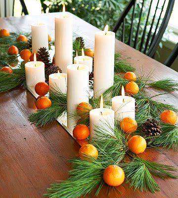 centro de mesa natal com velas e frutas