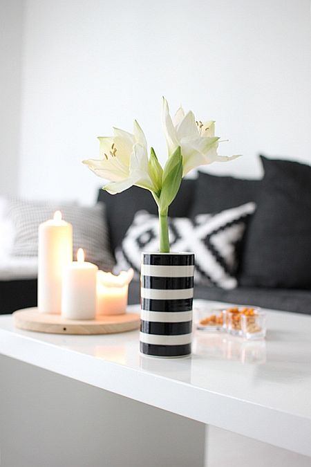 lovely and simple decoration with black and white vase and lilies