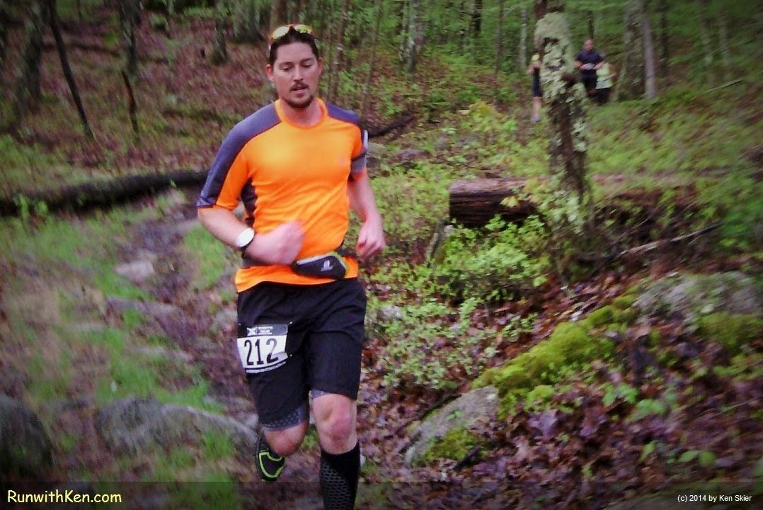 Up-close action photo of a trail runner at the XTERRA Trail Series MA #1--Wallum Lake--in Douglas, MA. Sports Photography from Inside the Pack by Ken Skier, The Running Photographer, aka