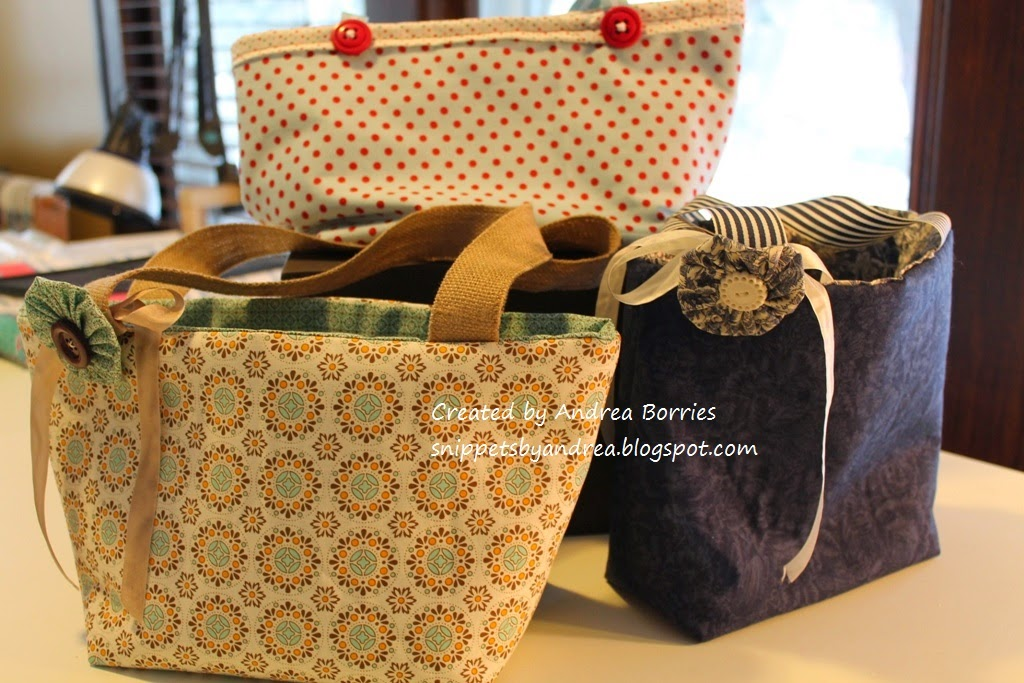 Reversible small bags made from coordinating fabrics and ribbon handles.