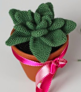 http://www.craftsy.com/pattern/crocheting/home-decor/agave-pattern-english/50239