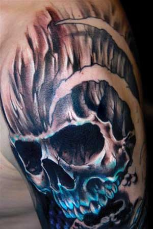 Skull in colors tattoo on shoulder