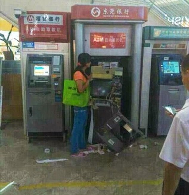Woman Rips Apart An ATM With Her Bare Hands