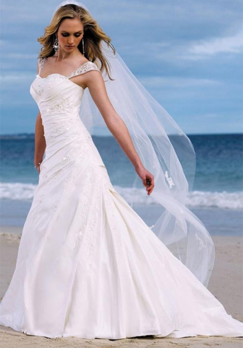 beautiful wedding gown on the beach