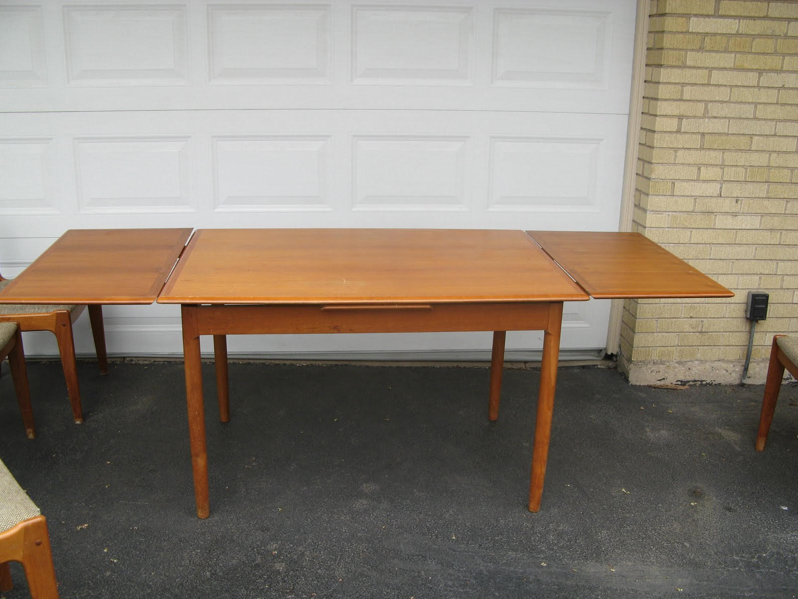 modern teak dining table and 4 chairs marked 39 made in denmark 39
