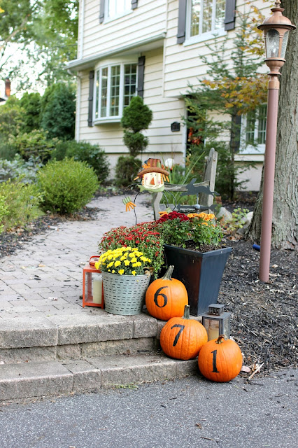 House number painted on pumpkins in fall display-www.goldenboysandme.com