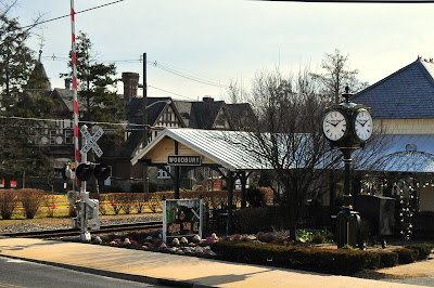 corner of Cooper and Railroad in Woodbury NJ. G. G. Green's Carriage House in background