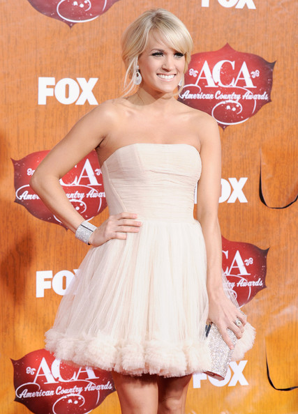 Celebrity hairstyle ideas carrie underwood loose bun updo hairstyle carrie underwood loose bun updo hairstyle at the american country awards pmusecretfo Image collections