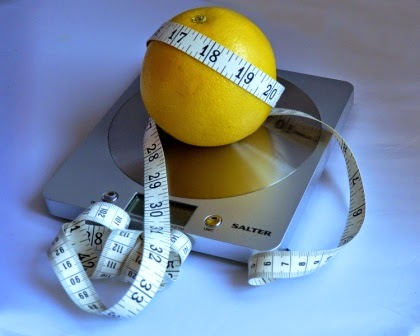 grapefruit, tape measure and scales