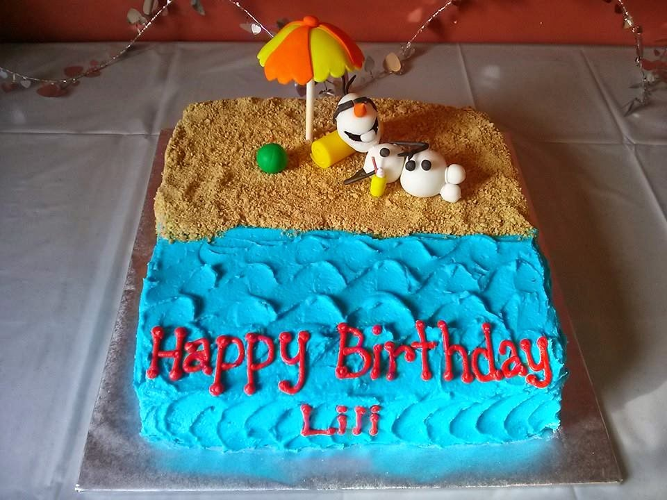 Olaf and the beach accessories are hand made with fondant and the