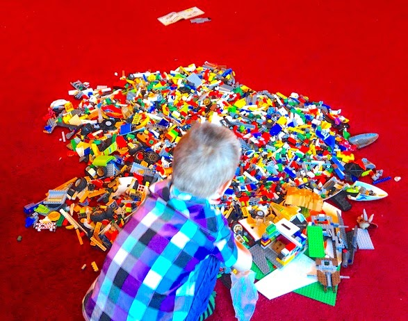 Morgan's Milieu | Why I love having the hardest job in the world (and you should too): A photo of LP playing in a pile of lego.