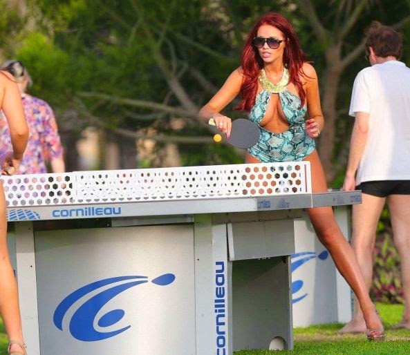 As you could see,‭ ‬Amy Childs enjoyed a sport activity to playing a ping pong in a blue swimsuit.
