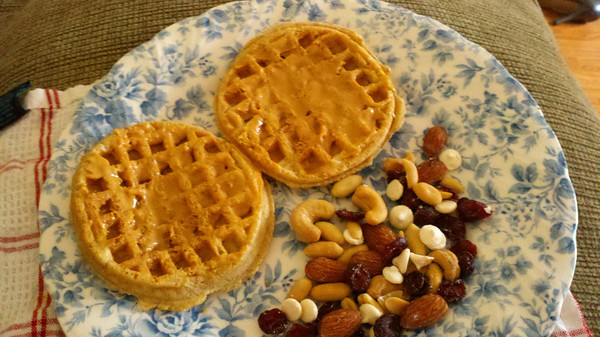 Whole Wheat Waffles with peanut butter and trail mix.