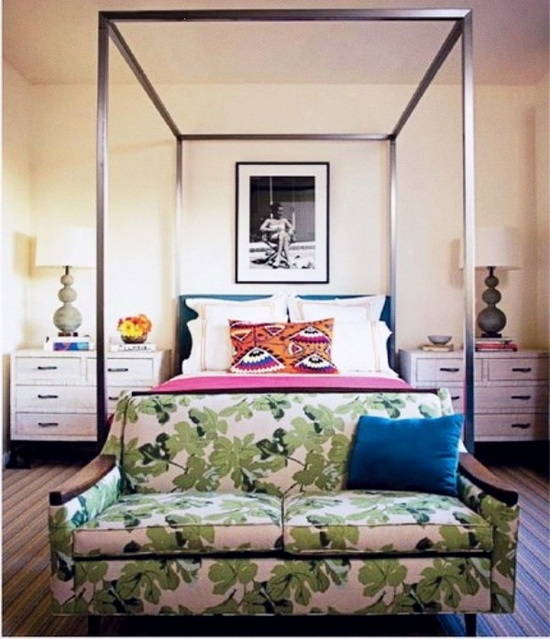 seating area at foot of bed, couch and coffee table at foot of bed, bedroom, coffee table, couch at foot of bed, interiors, interior design, interiors inspiration, orange settee, green couch, floral couch, eclectic design, mixed patterns