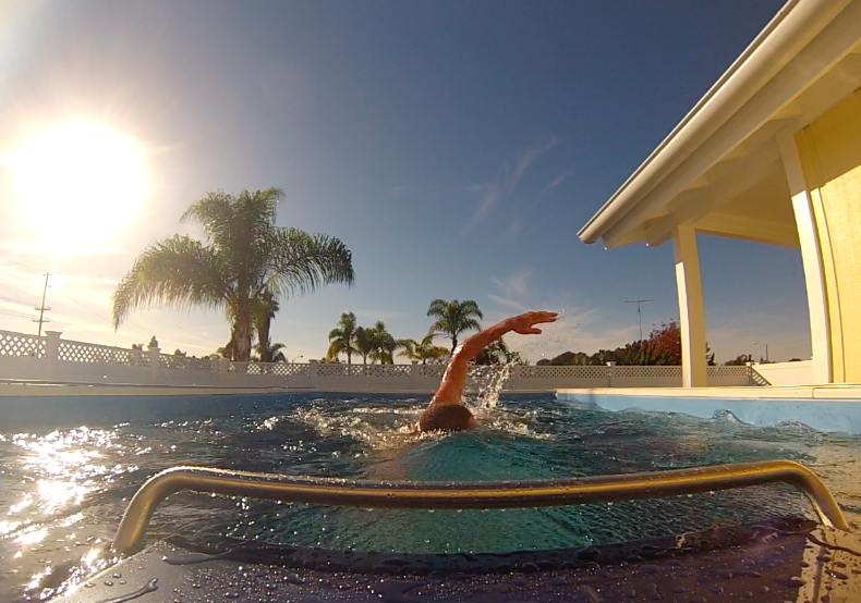 Professional triathlete Luke McKenzie takes his inaugural swim in the Elite Endless Pool in his California backyard.