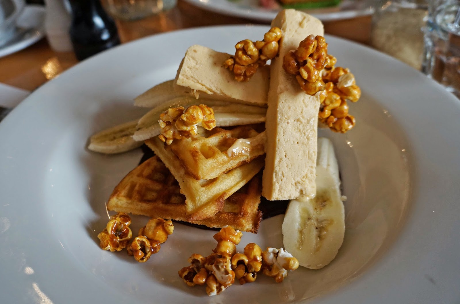 Waffles with peanut butter parfait, banana, dark chocolate and candied ...