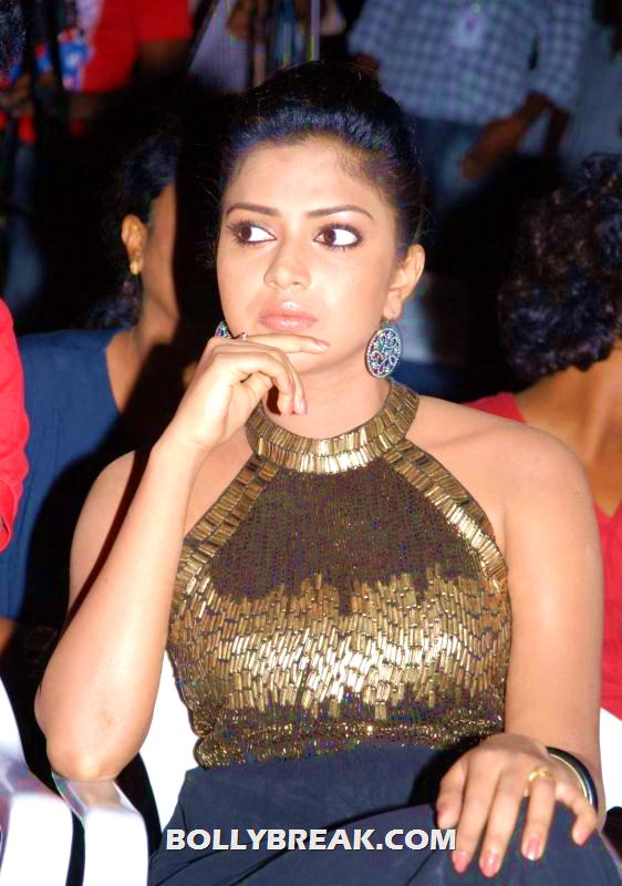 Amala Paul posing in black and gold dress at launch photo - Amala paul black and gold dress photos