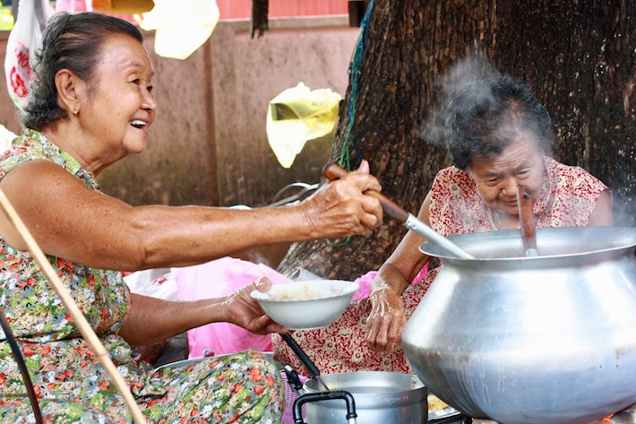 two old ladies serving siam laksa in penang
