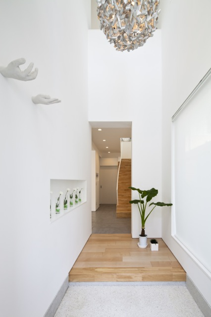 Narrow hallway and minimalist interiors
