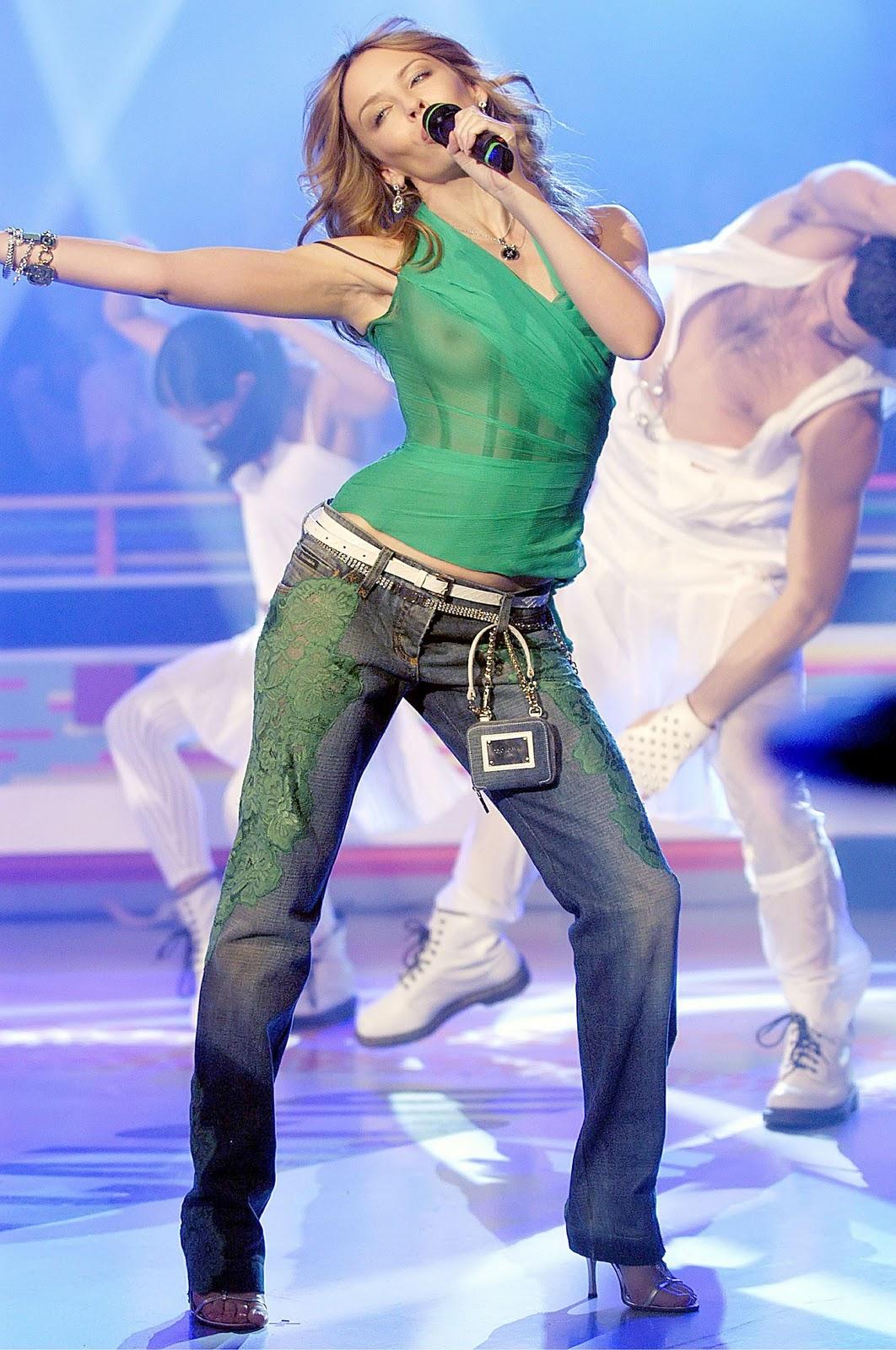 http://3.bp.blogspot.com/-y0WP9ZnwAk4/TVXib2lZryI/AAAAAAAAAMA/AekgeThjV88/s1600/Kylie+Minogue+See-Through+Boobie+Revealing+Green+Top+www.GutterUncensored.com+005.jpg