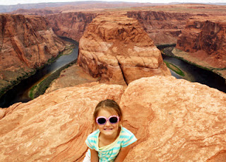 Tessa at Horseshoe Bend in Page. I wasn't about to set her closer to edge to get the better shot below.