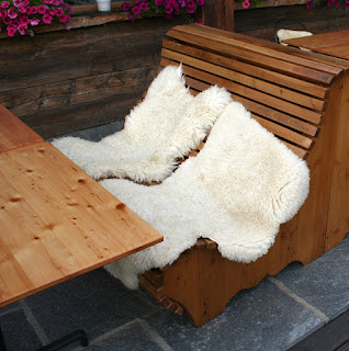 Sheep skins on the tables outside