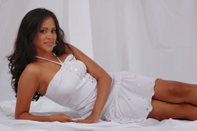 Kishani Alanki on bed in white