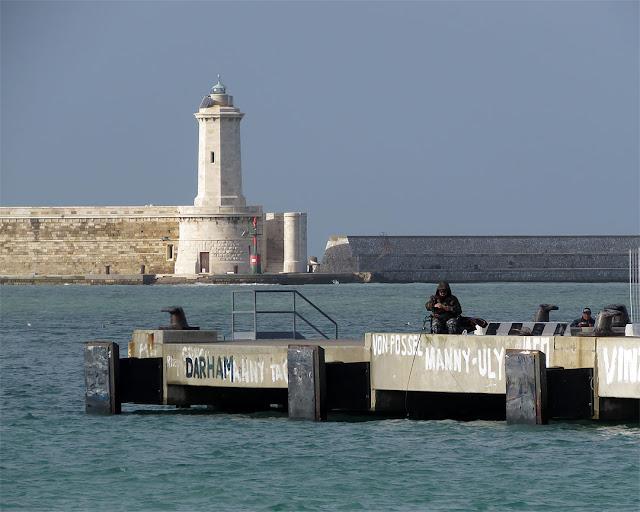 Fishing in january, Capitaneria pier, port of Livorno