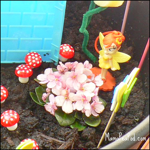 fairy flowers and toadstools in imaginary play garden
