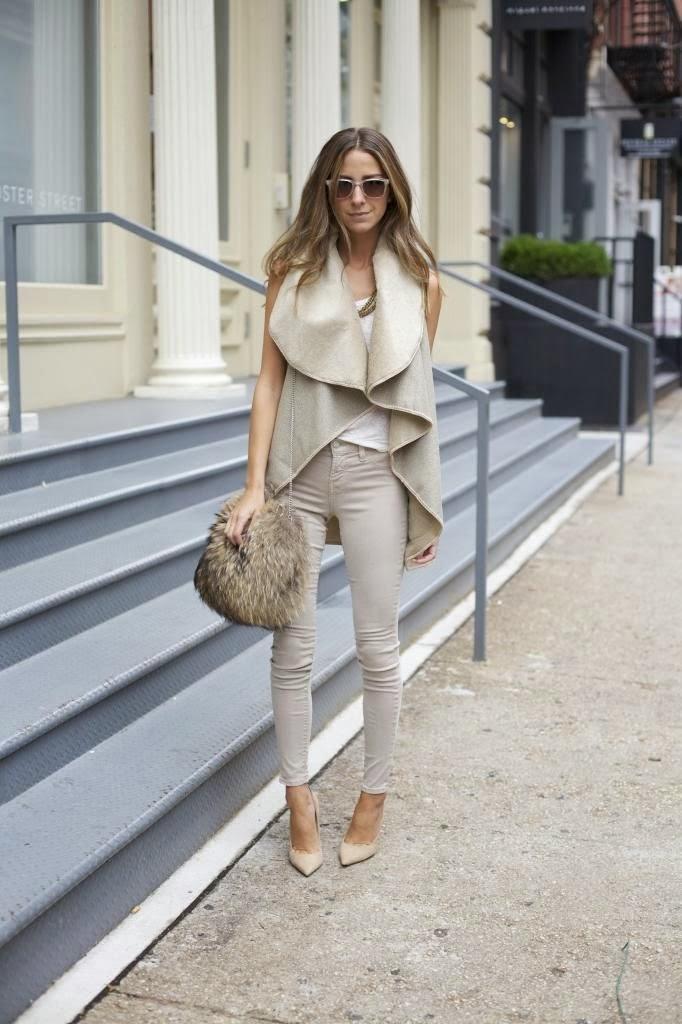 beige coat, periwinkle pants and stylish handbag