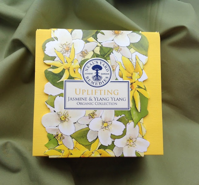 Picture of box, yellow with whit flowers on the sleeve. Uplifting Jasmine & Ylang Ylang.