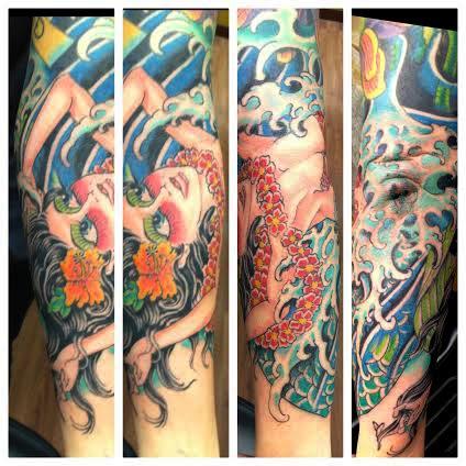 Sleeve tattoo of Hawaiian girl in waves by tattoo artist Jason Kunz for Triumph Tattoo