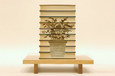Wonderful Art Carved into Books Seen On www.coolpicturegallery.us