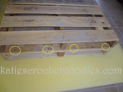 drilling-wood-pallets-diy-ottoman.JPG