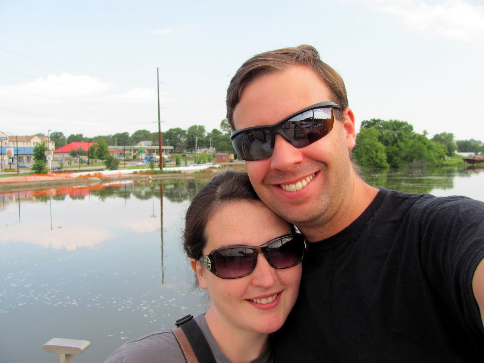 Cory and Sara posing on the Iowa River Power bridge after the 2013 American Road Trip