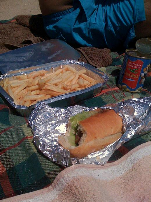 sandwhich and fries potatoes at the beach