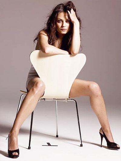 http://i1089.photobucket.com/albums/i348/13thfloorgrowingold/PhotoEditor_mila-kunis-gq-sexy-pictures-03.jpg