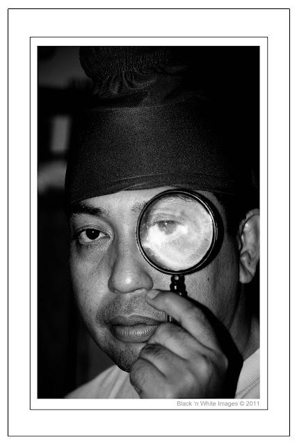 man an magnifier