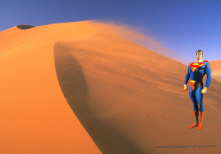 Desktop Wallpaper of Superman Standing Tall in Desert Wind background image