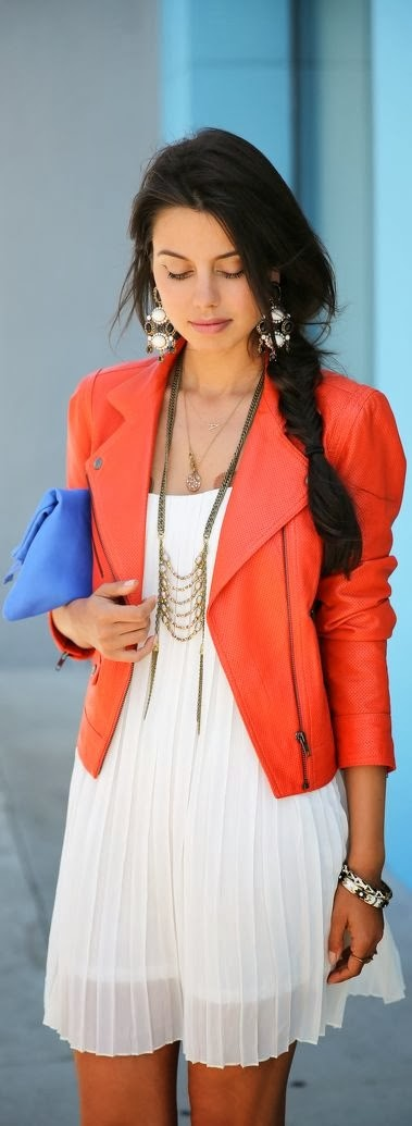 Orange blazer, white gown and blue hand bag