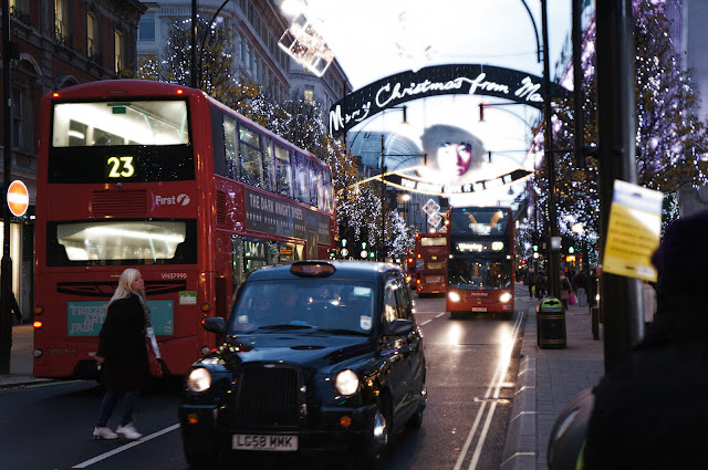 London Oxford St Christmas Black Cab and Red Bus