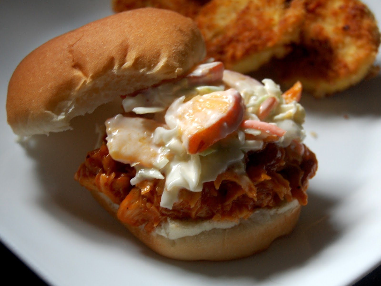 Peach BBQ pulled chicken sandwiches with peach coleslaw .