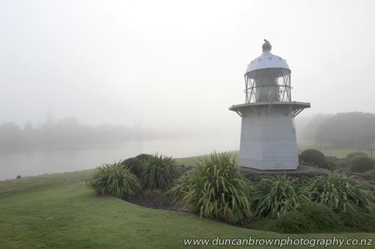In the fog: Historic Portland Island Lighthouse, Marine Parade, Wairoa photograph