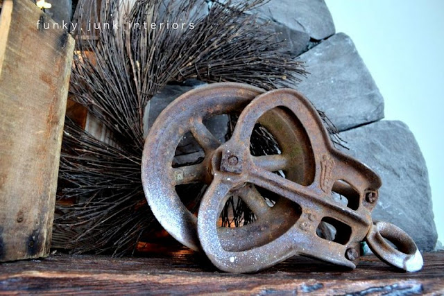 rusty pulley  / How to decorate a junk style mantel via http://www.funkyjunkinteriors.net