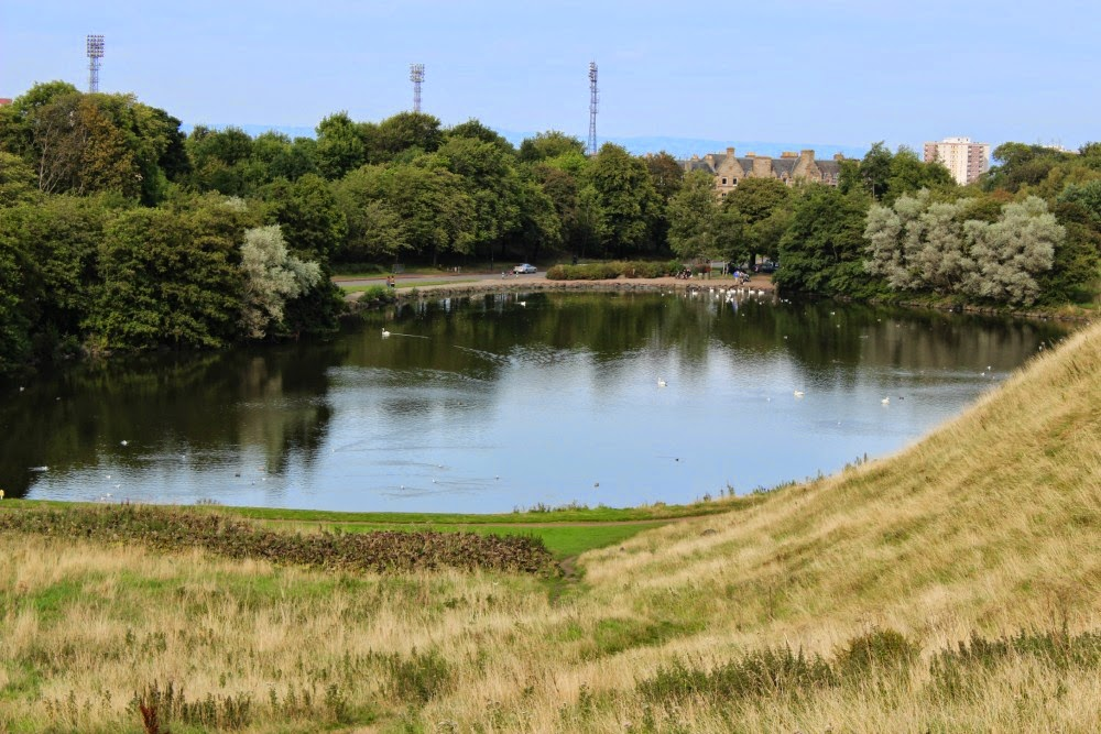 swans on st. margaret's loch, arthur's seat, edinburgh