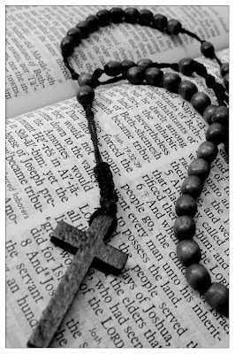 cross rosary on bible