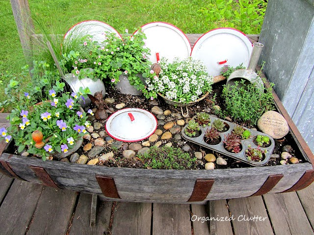 The yard gardens and patio of a junk collector organized clutter - Fairy garden containers for sale ...