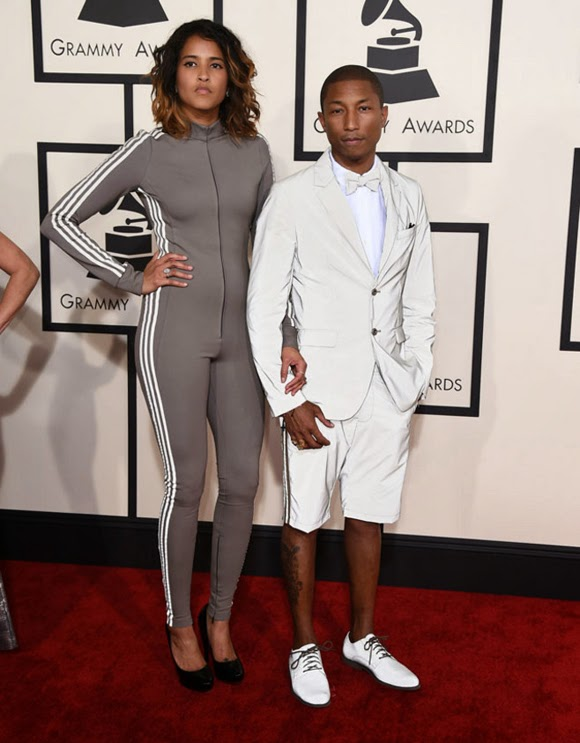 Pharrell Williams y Helen Lasichanh en los Grammy 2015 a punto de salir a hacer running